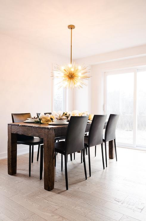 Chic Black Leather And Wood Dining Chairs Brass Sea Urchin Chandelier In Dining Room Contemporary Dining