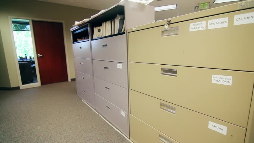 Chic Large Filing Cabinets A Man Searches Through Large Filing Cabinets At His Business Stock