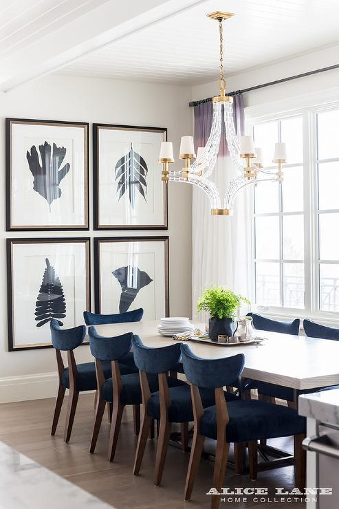 Stylish Blue And White Dining Chairs Navy Blue Velvet Dining Chairs With Large Crystal Cube Chandelier